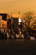 The late afternoon sun is sinking fast, and highlighting the small downtown section of Hinckley, IL.