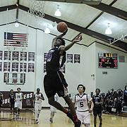 St. Thomas More Center Elias Revelle (35) dunks the ball on a fast break during a regular season high school basketball game between Caravel Academy and St. Thomas More Sat. Jan. 14, 2016 at Caravel Academy in Bear.