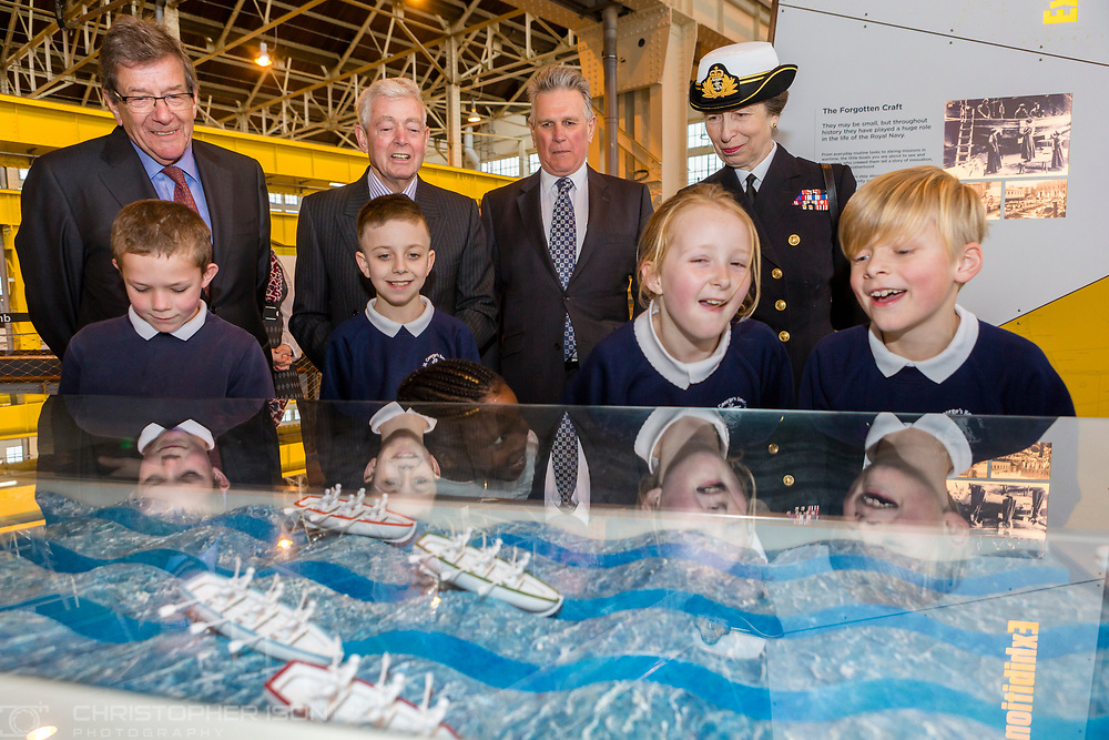 HRH The Princess Royal watches children play a boat race during her commemorative visit to Boathouse 4 at Portsmouth Historic Dockyard today. The Boathouse opened last year following a &pound;5.7million restoration and features a boatbuilding academy, The Forgotten Craft exhibition, family activities and Midships restaurant.<br /> Picture date: Monday March 20, 2017.<br /> Photograph by Christopher Ison &copy;<br /> 07544044177<br /> chris@christopherison.com<br /> www.christopherison.com
