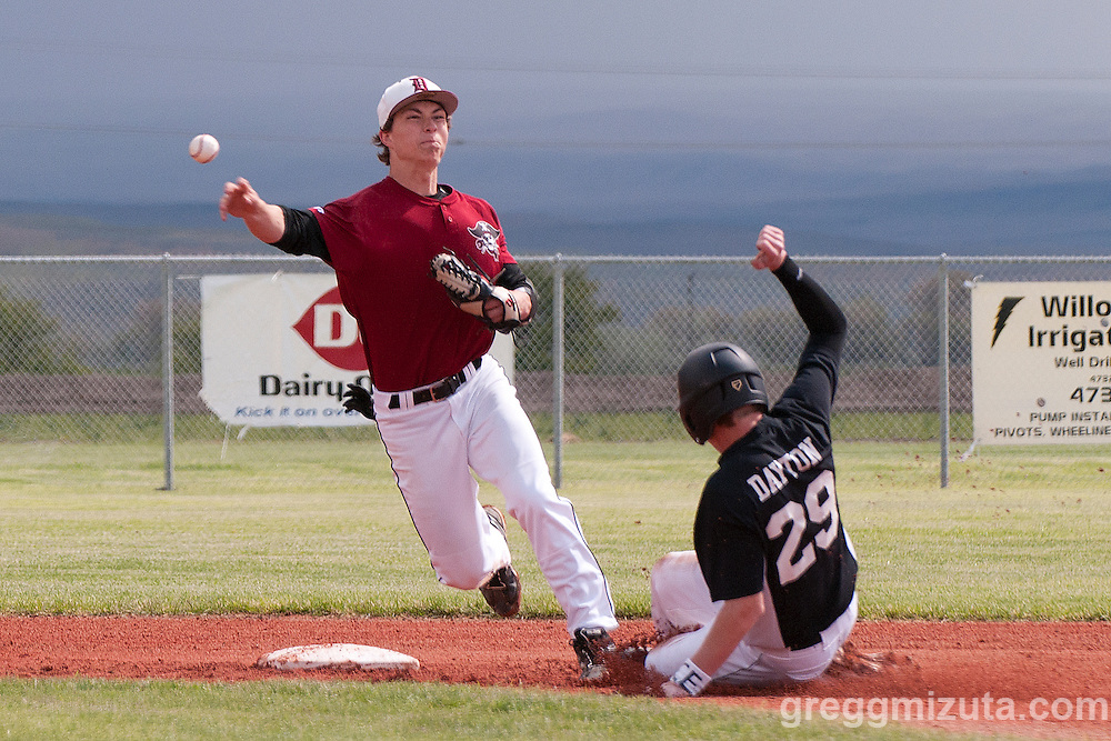 Dayton shortstop Gabe Louthan attempts to turn two while Vale's Austin Dayton slides into second during the quarterfinals playoff game on May 27, 2011 at Cammann Field, Vale, Oregon.