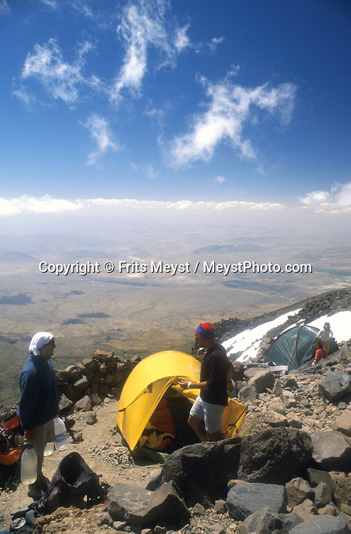 MOUNT ARARAT, TURKEY, AUGUST 2002. Mountaineers prepare for the climb in camp two at 4200 meters .  Mount Ararat is with its 5137 meters the highest mountain in Turkey. It has been closed to foreigners until 2001, due to guerilla activity on the mountain. Photo by Frits Meyst/Adventure4ever.com