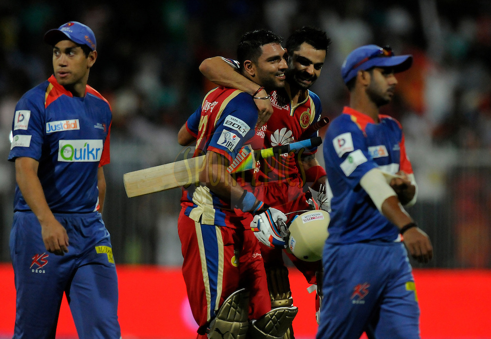 Yuvraj Singh of the Royal Challengers Bangalore and Virat Kohli captain of the Royal Challengers Bangalore celebrate after winning match 2 of the Pepsi Indian Premier League Season 7 between the Delhi Daredevils and The Royal Challengers Bangalore held at the Sharjah Cricket Stadium, Sharjah, United Arab Emirates on the 17th April 2014<br /> <br /> Photo by Pal Pillai / IPL / SPORTZPICS