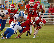 Washington's Bubba Marsh sheds the tackle from Bridge Creek's Mason Trevino.  - Nicholas Rutledge / For The Transcript