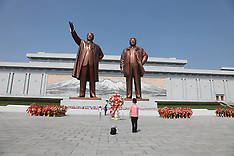 AUG 15 2014 People pay tribute at the Mansudae Square