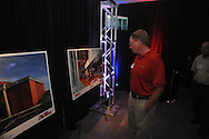 Fans look over drawings as Ole Miss announces a $150 million capital improvement campaign to build a new basketball arena and expand Vaught-Hemingway Stadium in Oxford, Miss. on Tuesday, August 9, 2011.