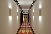 Refurbished Corridor showing new paintwork lighting, & carpet. view to stairwell