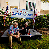 TAMPA, FL -- September 2, 2011 -- Supporters chat on the stage after listening to Republican presidential candidate, former Massachusetts Gov. Mitt Romney, at his new campaign headquarters in downtown Tampa, Fla., on Friday ,September 2, 2011 .
