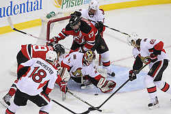 Apr 7; Newark, NJ, USA; Ottawa Senators goalie Craig Anderson (41) battles New Jersey Devils left wing Ilya Kovalchuk (17) and New Jersey Devils center Travis Zajac (19) for the puck during the third period at the Prudential Center. The Devils defeated the Senators 4-2.