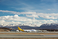 DHL cargo jet at Stevens Anchorage International Airport in Southcentral Alaska with the Chugach Mountains in the background. Spring. Afternoon.