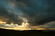 Sunset in Easter Island with the silhouette of moai at Hanga Roa