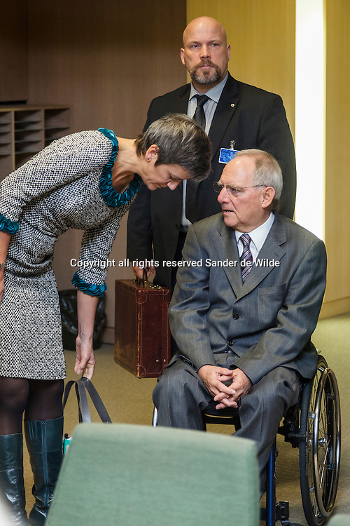 The European Union's Economy and Finance Ministers convene in Brussels on Tuesday, November 13, 2012, to discuss ongoing dossiers aimed at strengthening the economic governance and financial framework of the EU.Danish Finance minister Margrethe Vestager puts her bag down and listens to German Finance Minister Wolfgang Schaeuble. The suitcase of Schaeuble is held by the man in the middle.
