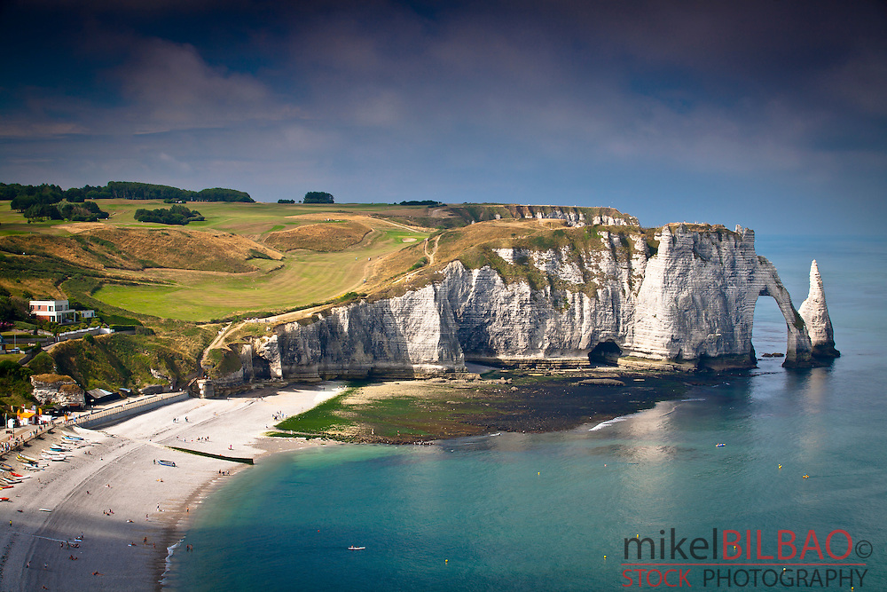 Cliffs, natural arch and stone beach.<br /> Etretat, Le Havre, Seine-Maritime, Normandy, France, Europe