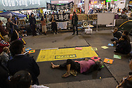 All along the protest site, various speeches attract small groups. Protesters known as the Umbrella Revolution or Occupy Mongkok, an extension of the larger Occupy Central movement, have taken over a number of blocks on the busy road and staged an ongoing demonstration calling for universal suffrage for Hong Kong.