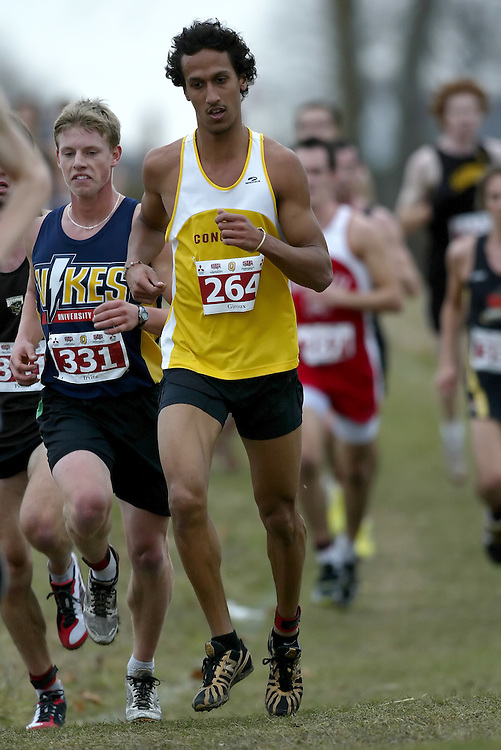 (Kingston, Ontario -- 14 Nov 2009)  SIMON-MALIK GIROUX of the Concordia University runs to 69 place at the  2009 Canadian Interuniversity Sport CIS Cross Country Championships at Forth Henry Hill in Kingston Ontario. Photograph copyright Sean Burges / Mundo Sport Images, 2009.