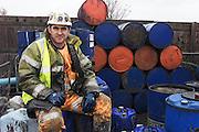 Waste oil reclamation worker