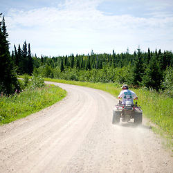 Uncle Ron leads the way towards the trail on his ATV in the Nopiming Provincial Park of northeastern Manitoba, Canada.