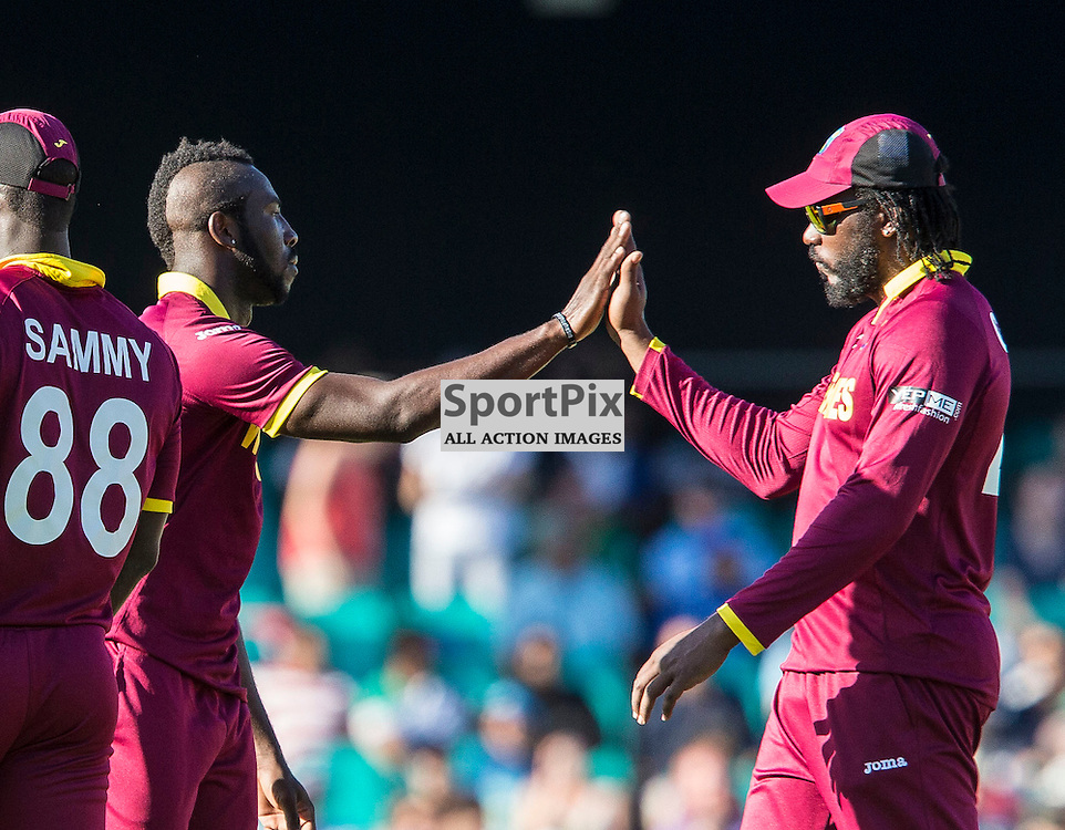 ICC Cricket World Cup 2015 Tournament Match, South Africa v West Indies, Sydney Cricket Ground; 27th February 2015<br /> wicket taker West Indies Andre Russell (left) high fives West Indies Chris Gayle