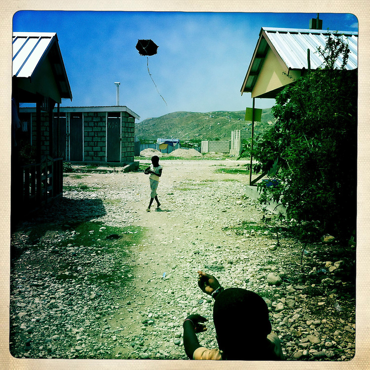 A boy flies a kite at the Corail camp on Thursday, April 5, 2012 in Port-au-Prince, Haiti.