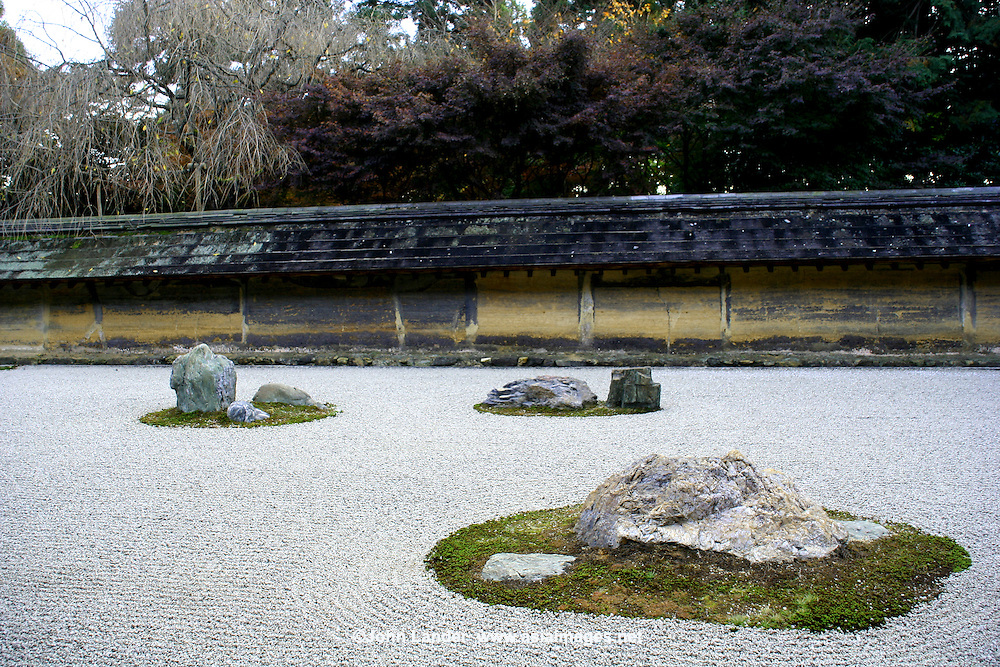 Ryoanji Temple zen garden is one of the world's best known gardens. The temple's main attraction is its rock garden - the most famous of its kind in Japan. The simple garden consist of nothing but rocks, moss and neatly raked gravel. The meaning of the garden's arrangement is up to each visitor's interpretation, though it is said that if you can see all of the fifteen stones at one time, you will have reached enlightenment.
