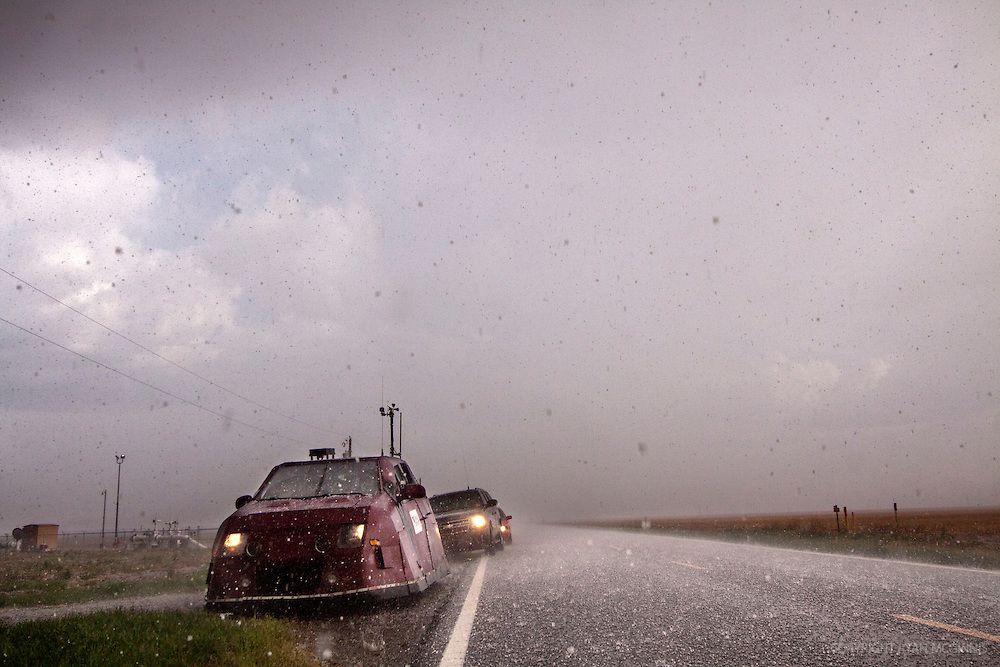 Reed Timmer rides out the hail in his armored vehicle designed to penetrate tornadoes, western Kansas, May 11, 2011.
