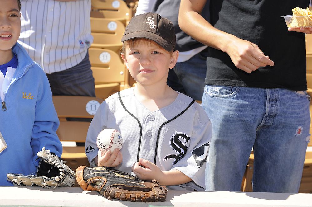 GLENDALE, AZ - FEBRUARY 28:  Young White Sox fans line up to get autographs prior to the game between the Los Angeles Dodgers and Chicago White Sox on February 28, 2011 at The Ballpark at Camelback Ranch in Glendale, Arizona.  The Dodgers defeated the White Sox 6-5.  (Photo by Ron Vesely)