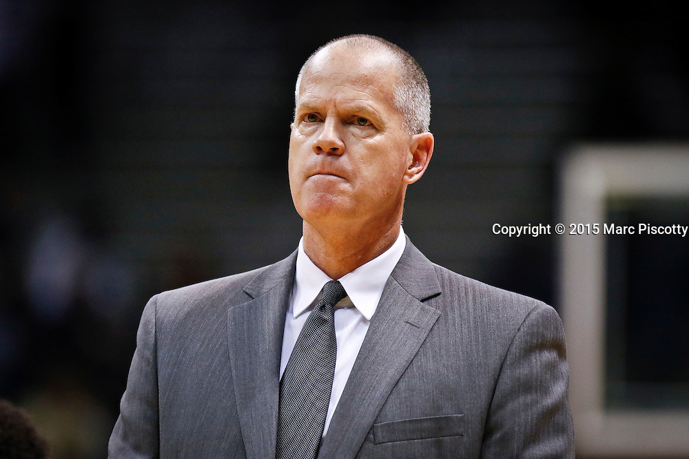 SHOT 1/22/15 10:29:41 PM - Colorado head basketball coach Tad Boyle wears the frustration of a loss on his face after playing Washington during their regular season Pac-12 basketball game at the Coors Events Center in Boulder, Co. Washington won the game 52-50 on a shot with less than a second to play in the game. (Photo by Marc Piscotty / © 2015)