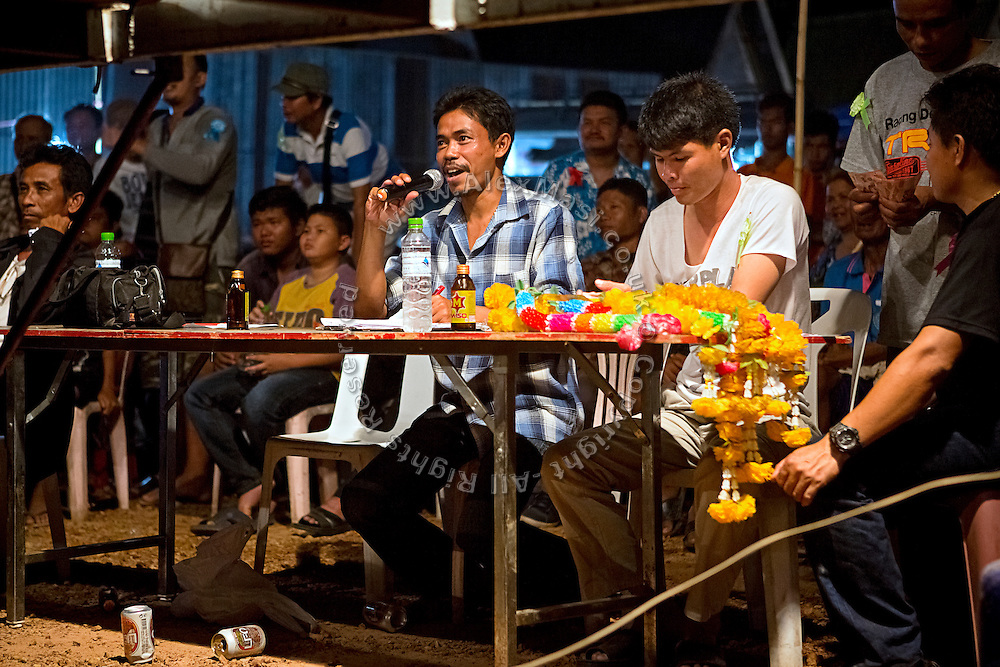 Announcements are being made to the crowd and fighters during a Muay Thai boxing event, organised in a village near Ubon Ratchathani, northeast Thailand.