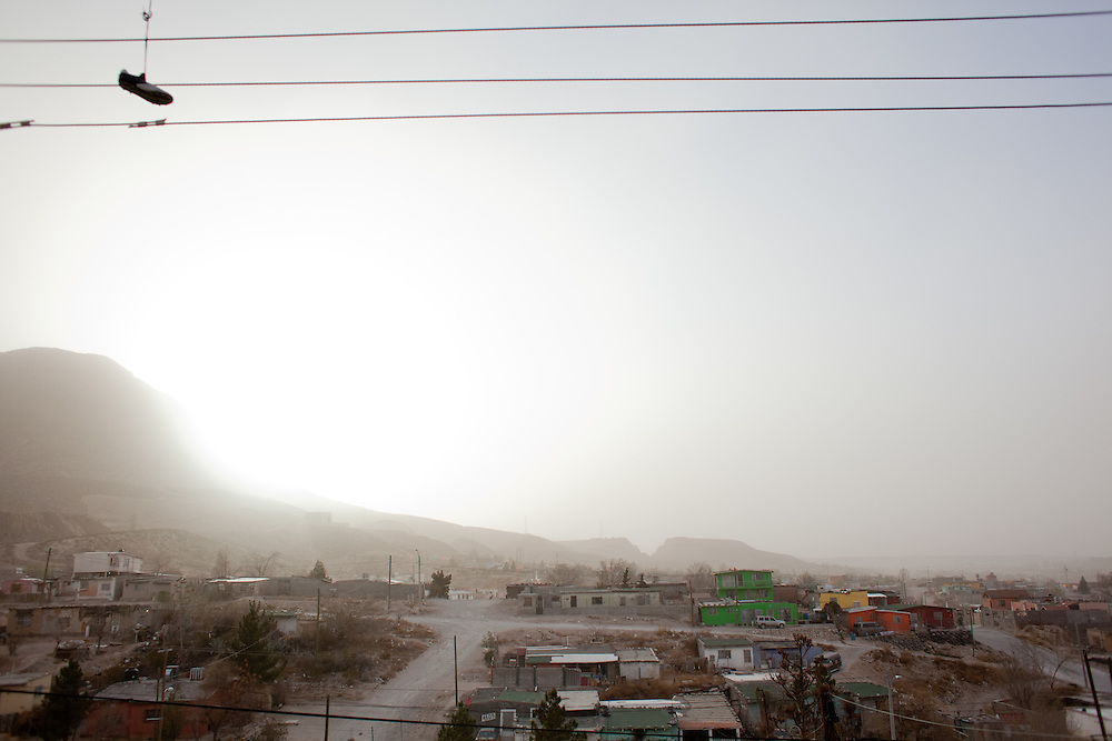 A view of the Diaz Ordaz colonia, one of the most impoverished areas of Ciudad Juarez, during a dust storm.