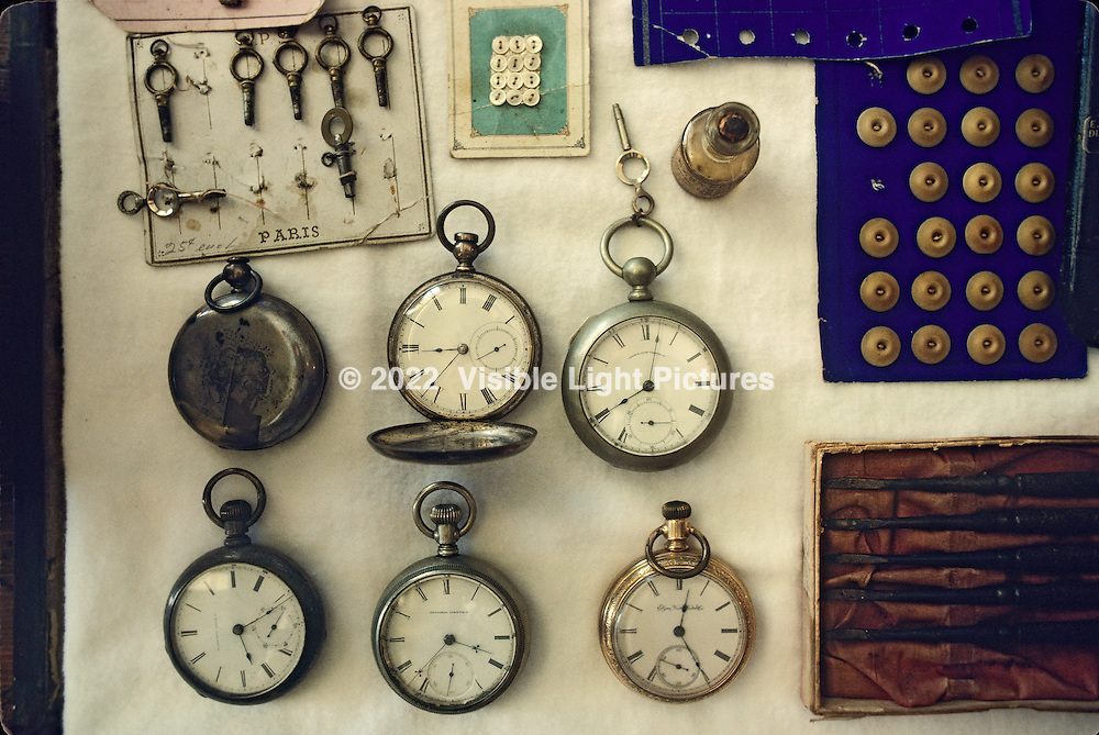 Mystic Seaport Village in Mystic, CT is home to a collection of authentic buildings on the original seaport site, dating back to the 1800's.  The general store offers a collection of antique period products, including these pocket watches,  assorted buttons and other period pieces.  I shot this with my Canon F1 and 24mm lens (with hood) resting on top of the display case.  Natural light came in through the top and sides of the case, eliminating any shadows from the camera itself.  Film stock was probably Kodak Ektachrome.  SHoot date was probably in the late 1980s