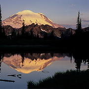 North America, United States, Northwest, Pacific Northwest, Washington, Mt. Rainier, Mt. Rainier National Park<br /> Massive Mount Rainier reflects in the icy waters of Tipsoo Lake at dawn, Mt. Rainier National Park, WA.