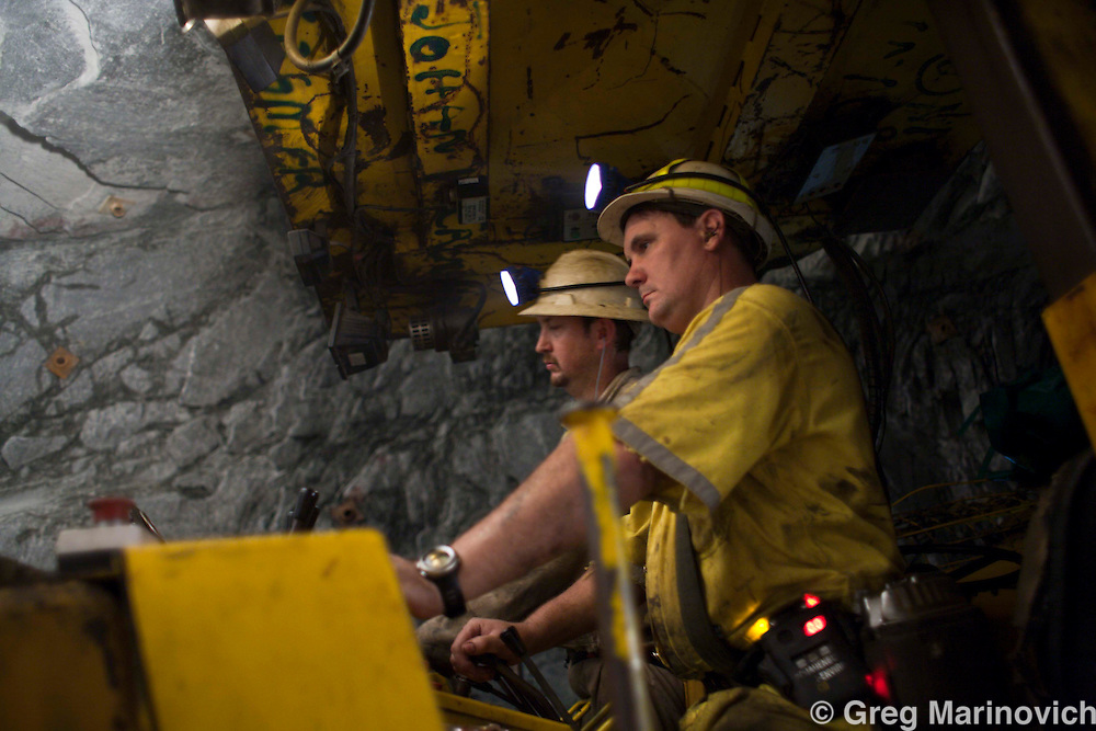 A team uses an mechanical driller to bore holes in which to place explosives to blast further at the deepest rockwall on Earth, and go beyond the record set the previous shift by AngloGoldAshanti . Theybroke the record and reached deeper into the earth than any other mine previously, with the Mponeng gold mine descending to 3778 meters below the surface Feb 3, 2009. Photo Greg Marinovich