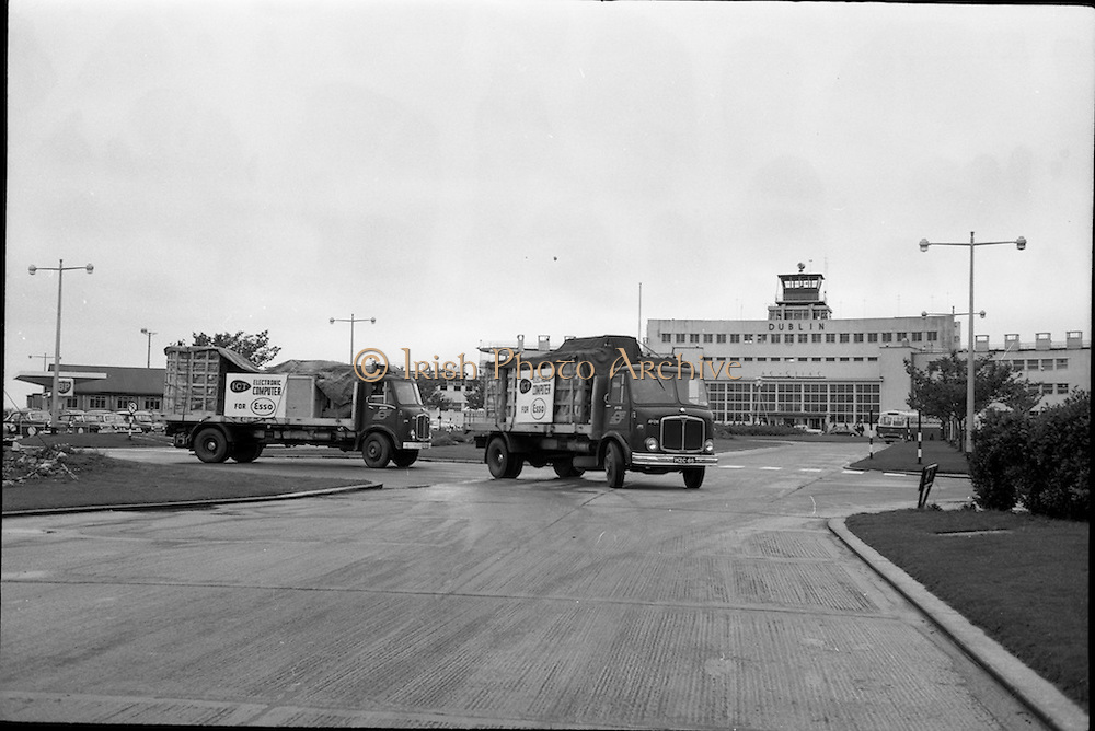 07/09/1963<br /> 09/07/1963<br /> 07 September 1963<br /> I.C.T. Computers for ESSO being delivered. The AEC Mercury trucks leave Dublin airport with the equipment securely on board. <br /> International Computers and Tabulators were a British based computer company that provided the first computers used in Ireland. These images were taken for Hugo B. Patterson, I.C.T. Regional Executive for Ireland.