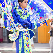 Thai performer marches on Hollywood Blvd in the Songkran Thai New Year parade
