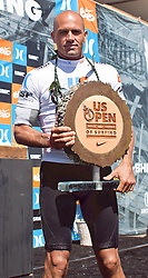 HUNTINGTON BEACH, California/USA (Sunday,Aug 7, 2011) 10-Time ASP World Champion Kelly Slater (Cocoa Beach, FL), 39, displays his award and grand prize at the awards ceremony platform late afternoon  at  the U.S. Open of Surfing 2011. Photo: Eduardo E. Silva.