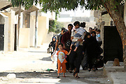 Residents flee as Free Syrian Army fighters fight against goverment  forces  in Karm al-Tarib, near Aleppo's international airport.Aleppo, Syria August 17,2012. (Photo by Heidi Levine/Sipa Press).