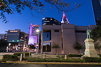 Evening falls in downtown Mobile, Alabama near the statue of Raphael Semmes. View features various buildings as seen in November 2015.