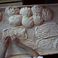Pide varies place to place in size, shape and thickness; all are scored with fingertips.
