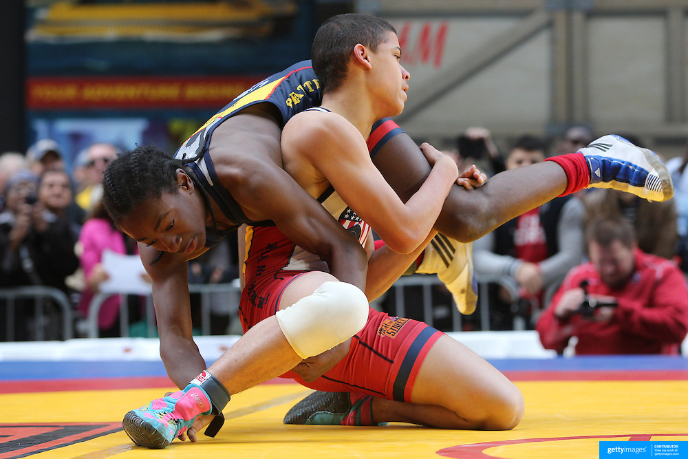 Boys competing in a youth wrestling exhibition match during the 'Beat The Streets' USA Vs The World, International Exhibition Wrestling in Times Square. New York, USA. 7th May 2014. Photo Tim Clayton