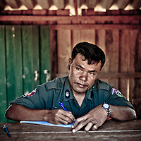 Cambodian chief of border police at a remote crossing near Koh Kong, Cambodia.