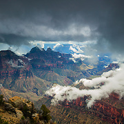 A heavy rainstorm closes in over the north rim of the Grand Canyon in Arizona. Several prominent peaks are visible in this view (from left to right): Angels Gate, Deva Temple, Brahma Temple and Zoroaster Temple.