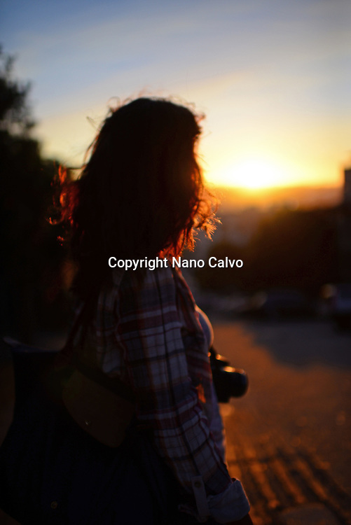 Young woman enjoying a beautiful sunset in San Francisco, California.