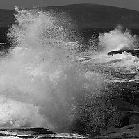 The Schoodic Peninsula is the only part of Acadia National Park that is on the mainland. It provides great coastal scenery with dramatic views but without the large crowds of Mount Desert Island. This is a wave crashing into Schoodic Point and splashing across the seascape. <br /> <br /> This Maine coastal B&amp;W photography image is available as museum quality photography prints, canvas prints, acrylic prints or metal prints. Black and white photography fine art prints may be framed and matted to the individual liking and decorating needs:<br /> <br /> http://juergen-roth.pixels.com/featured/maine-schoodic-peninsula-juergen-roth.html<br /> <br /> All photographs are available for digital and print image licensing at www.RothGalleries.com. Please contact me direct with any questions or request.<br /> <br /> Good light and happy photo making!<br /> <br /> My best,<br /> <br /> Juergen<br /> Prints: http://www.rothgalleries.com<br /> Photo Blog: http://whereintheworldisjuergen.blogspot.com<br /> Twitter: @NatureFineArt<br /> Instagram: https://www.instagram.com/rothgalleries<br /> Facebook: https://www.facebook.com/naturefineart