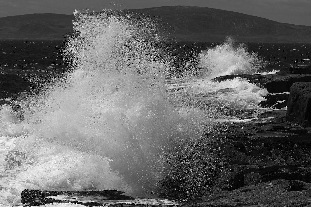 The Schoodic Peninsula is the only part of Acadia National Park that is on the mainland. It provides great coastal scenery with dramatic views but without the large crowds of Mount Desert Island. This is a wave crashing into Schoodic Point and splashing across the seascape. <br />