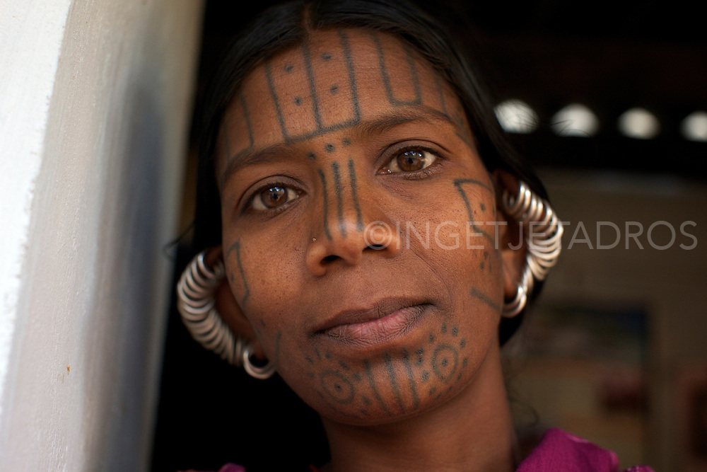 The women from the Desia Kondh tribe are readily identifiable by their geometric facial tattoos that on close observation bear striking similarity to tiger's whiskers. These identifying marks ensure they will recognize each other in the spirit world.<br /> Nowadays these facial tattoes are getting less done.<br /> Orissa, India,2011