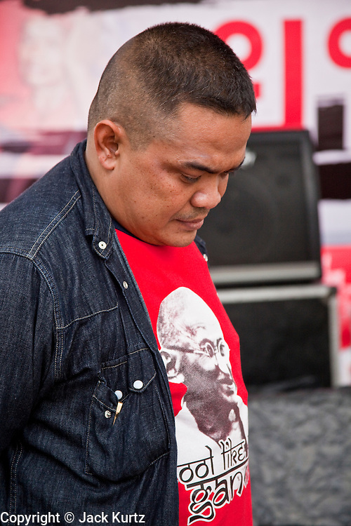 "17 MAY 2010 - BANGKOK, THAILAND: JUTAPORN PROMPAN, a Red Shirt core leader, just before he announced to the Red Shirts that their unofficial military commander ""Seh Daeng"" had died. The Thai government announced Monday that the Red Shirts unofficial military commander and renegade Thai Army Maj. Gen. KHATTIYA ""Seh Daeng"" SAWASDIPOL, died Monday from wounds he suffered when a sniper shot him in the head on May 12 while he was being interviewed by an American reporter. When the announcement was read to the Red Shirt protesters still camped out in Ratchaprasong intersection in Bangkok many started weeping.   PHOTO BY JACK KURTZ"