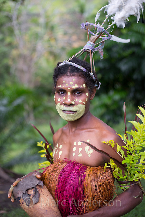 Portrait of a tribal woman wearing traditional dress in a small village in the Erap valley, Papua New Guinea