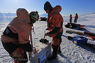 Marine chemists Melissa Chierici (Institute of Marine Research) and Agneta Fransson (Norwegian Polar Institute)process seawater sample collected beneath frozen fjord; Kongsfjorden, Svalbard, Norway.