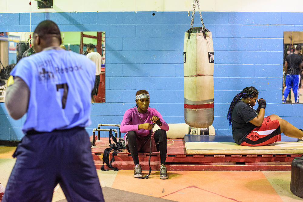 Baltimore, Maryland - January 26, 2017: Jack Moore, 21, with bandana, and Aalliyeh Clinton, 16, right, train at the Upton Boxing Club in Baltimore Thursday January 26, 2017.<br /> <br /> CREDIT: Matt Roth for The New York Times<br /> Assignment ID:
