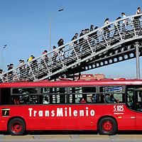 Passengers exit from a bus stop of the Trans Milenio, Bogotá's new bus system, on Thursday, September 28, 2006. The bus system has had dramatic effects on Bogotá's traffic problem making commutes faster and easier for the citizens. (Photo/Scott Dalton).