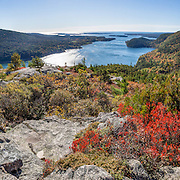 Hike Acadia Mountain Trail for good views of Somes Sound and typically peak fall colors in the second week of October, in Acadia National Park, Bar Harbor, Mount Desert Island, Maine, USA. Hike granite peaks and enjoy Atlantic coastal scenery. Originally created as Lafayette National Park in 1919, the oldest National Park east of the Mississippi River, it was renamed Acadia in 1929. During the last glacial maximum 21,000 years ago, glaciers measuring up to 9,000 feet thick cut into granite ridges, sculpting the fjord-like Somes Sound. The panorama was stitched from 15 overlapping photos.